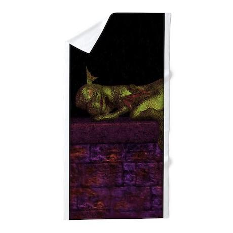 Let sleeping dragons lie Beach Towel