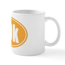 10k orange oval Mug