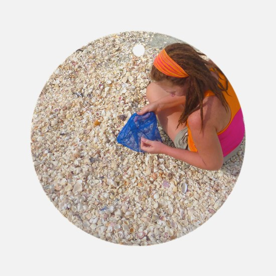 Sifting Through a Mound of Seashell Round Ornament