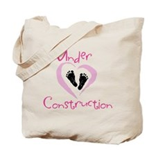 under contruction_girldark.png Tote Bag