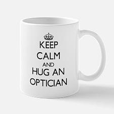 Keep Calm and Hug an Optician Mugs
