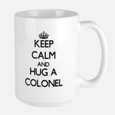 Keep Calm and Hug a Colonel Mugs