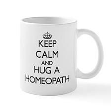 Keep Calm and Hug a Homeopath Mugs
