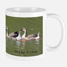 ducks in a row Mugs