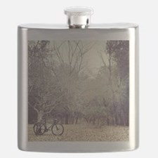 Bicycle awaits at entrance to forest. Flask