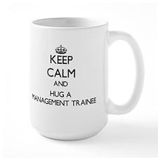 Keep Calm and Hug a Management Trainee Mugs