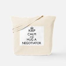 Keep Calm and Hug a Negotiator Tote Bag