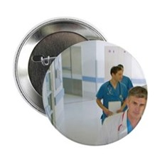 """Team of surgeons walking in hospital  2.25"""" Button"""