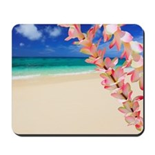 Beach with flowers in foreground Mousepad