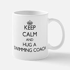 Keep Calm and Hug a Swimming Coach Mugs