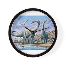 Apatosaurus group on beach Wall Clock