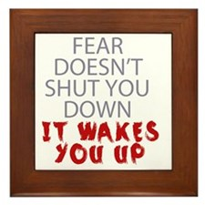 Fear doesnt shut you down it wakes you Framed Tile