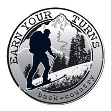 earn your turns black Round Car Magnet