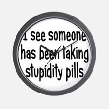 stupiditypills1 Wall Clock