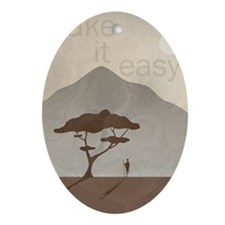 African Scene with Tribesman take it Oval Ornament