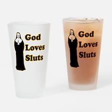 God loves sluts Drinking Glass
