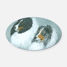 Blue and Tri Sheltie Heads Oval Car Magnet