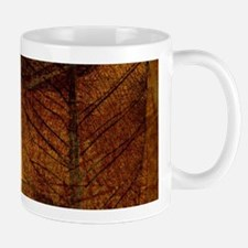 brown leaf print Mugs