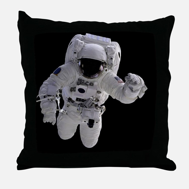 a 75 kg astronaut floating in space throws - photo #9