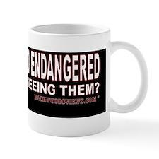 IF WOLVES ARE SO ENDANGERED.gif Mug