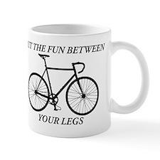 PUT THE FUN BETWEEN YOUR LEGS Mugs