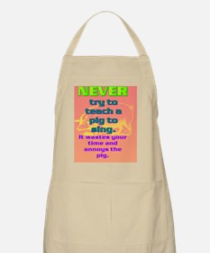 NEVER try to teach a pig to sing(small post Apron