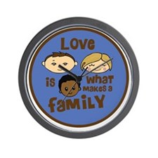 love is what makes a family blue boy co Wall Clock