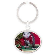 Possum on Christmas sled Oval Keychain