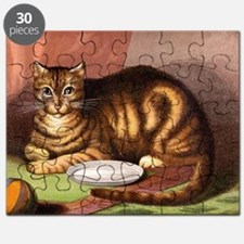 Relaxing striped cat with food dish Puzzle