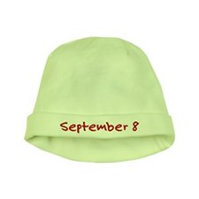 """September 8"" printed on a baby hat"