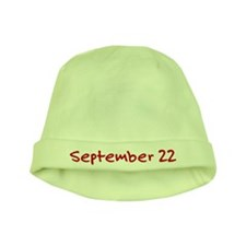 """September 22"" printed on a baby hat"