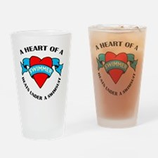 Heart of a Swimmer tattoo Drinking Glass