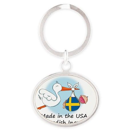 stork baby swe 2 Oval Keychain