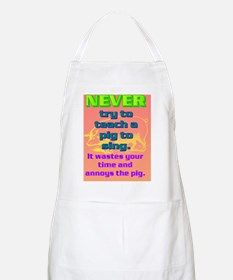 NEVER try to teach a pig to sing(framed pan Apron