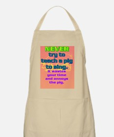 NEVER try to teach a pig to sing(oval portr Apron