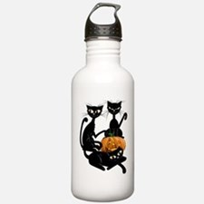 Three Black Kitties an Water Bottle