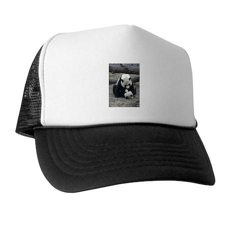 Mei hugs Tai Trucker Hat