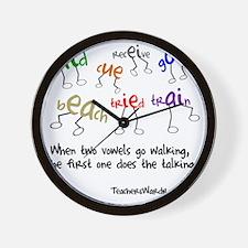 Two Vowels Go Walking Wall Clock