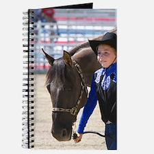 Girl showing her 4-H blue ribbon winning h Journal
