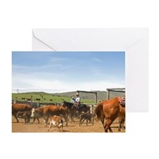 Cowboys rounding up cattle for brand Greeting Card