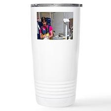 Worker bottling milk in glass b Travel Mug