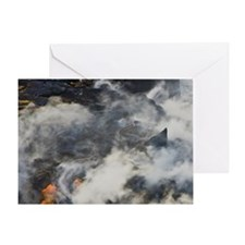 Molten lava flows into the ocean at  Greeting Card