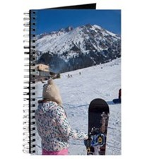 Girl with snowboard watching another falle Journal