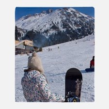 Girl with snowboard watching another Throw Blanket