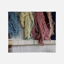 Turkish woman carpet weaving at the  Throw Blanket