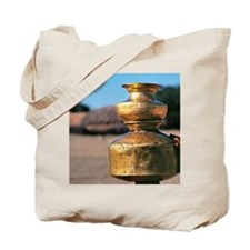 A woman balances brass water pots on her  Tote Bag
