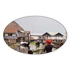 Stilt village. Women rowing boats t Decal
