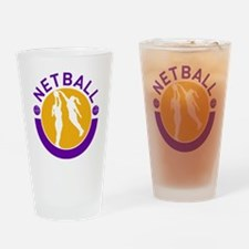 Netball player shooting blocking th Drinking Glass