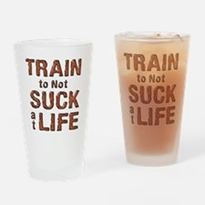 Train to not Suck at Life Drinking Glass