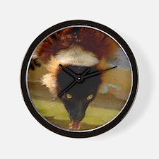 A Red Ruffed Lemurs drinking Wall Clock
